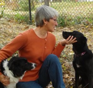 the trainer, Julie Humiston, with her border collie and lab mix